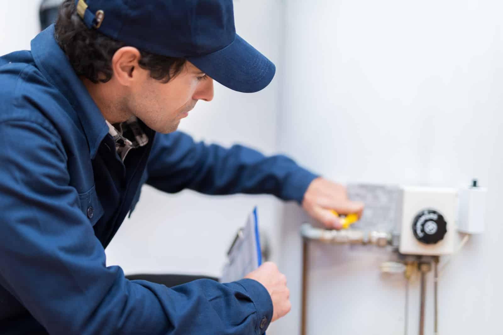 a plumber repairing a water heater